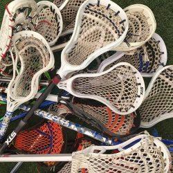lacrosse-sticks-on-grass